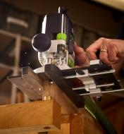 Using a router, a CRB7 router base and a mortise, hinge, lock and flute attachment to cut a mortise