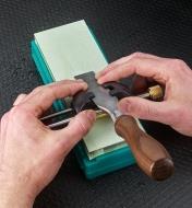 Sharpening a chisel on a Ha No Kuromaku ceramic stone