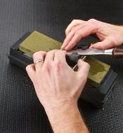 Using a stone holder to hold a stone while sharpening