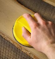 "Sanding a wood panel using the 5"" disc sanding block"