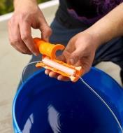 Clipping a Bigg Gripp bucket handle over a plastic bucket handle