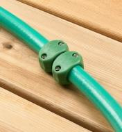 The hose mender used to link two sections of garden hose