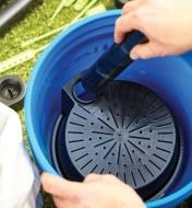 Connecting a tube to the reservoir inside a bucket