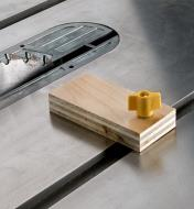 A table saw stop block made from a Zeroplay miter stop and a block of plywood