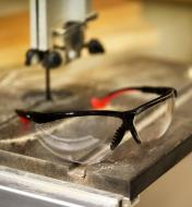 Professional Safety Glasses sitting on a bandsaw table