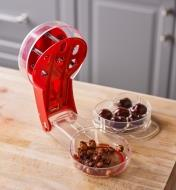 The receptacle of the six-cherry pitter holds pits for eventual disposal