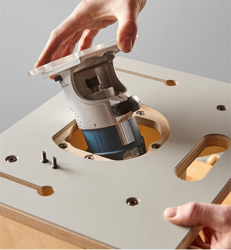 Inserting the compact router and base plate into the Veritas table for compact routers
