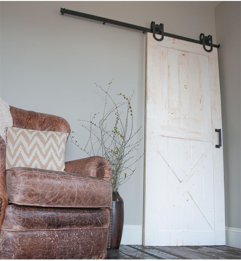A door mounted with Horseshoe Barn-Style Door Hardware