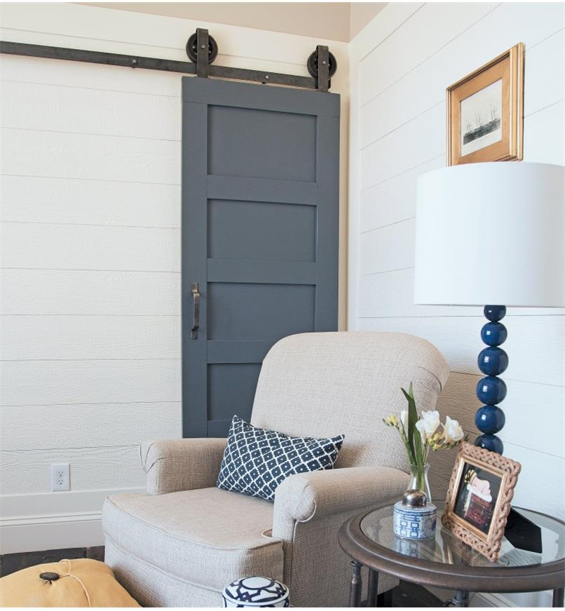 A door mounted with Artisan Barn-Style Door Hardware