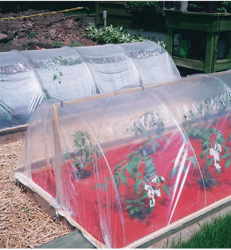 Hoops used to hold plastic film over garden rows