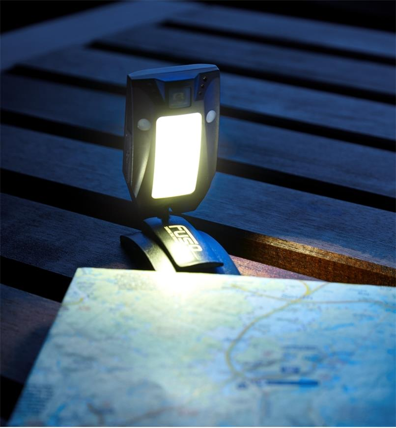 Detached from the band, the base of the multi-function LED headlamp is used freestanding
