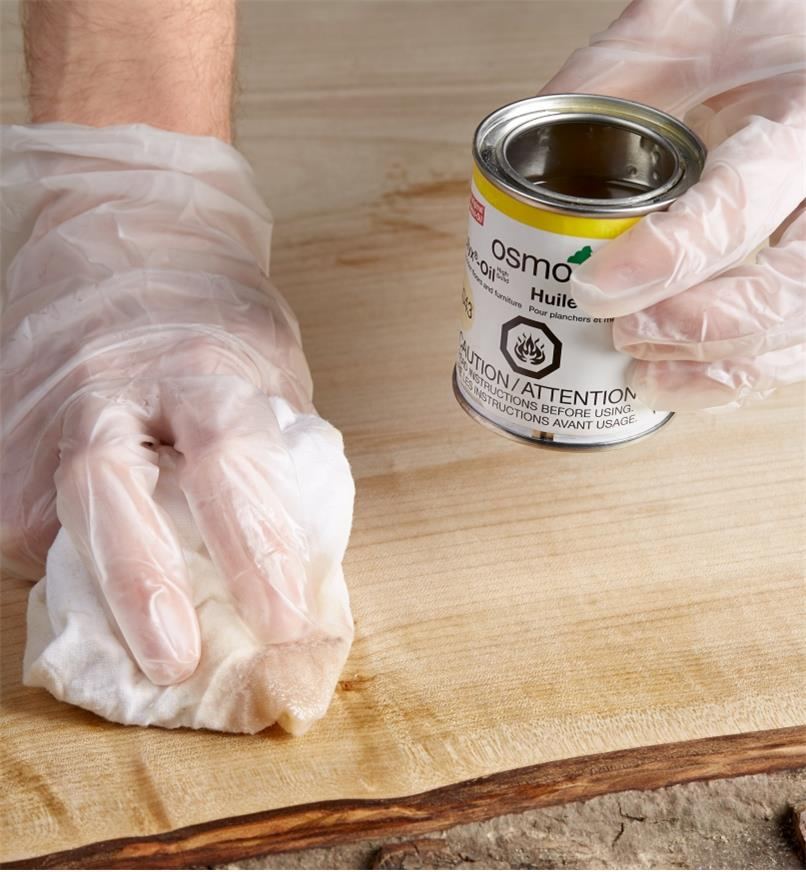 Wiping Osmo Polyx hard wax oil onto wood using a cloth
