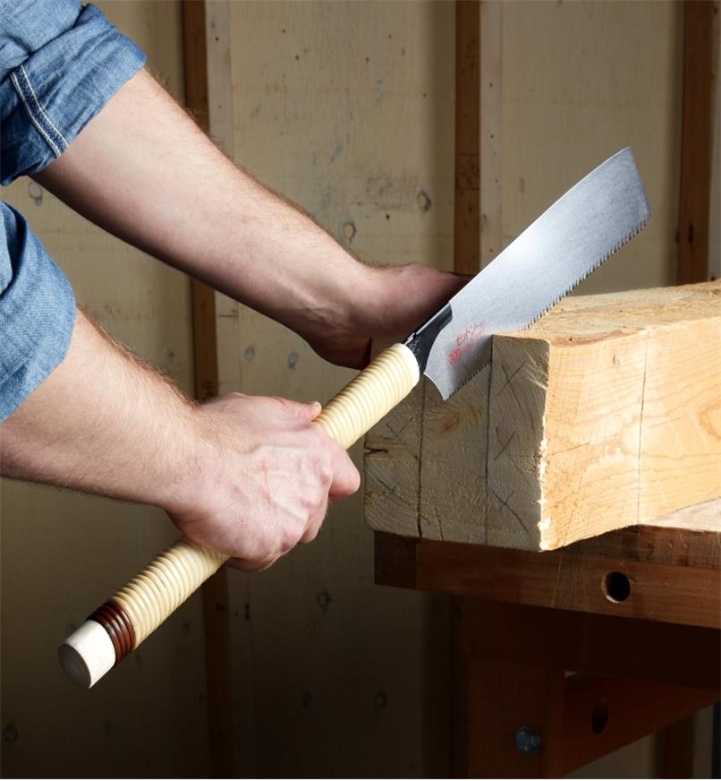 A rip-tooth kataba being used to create a tenon on the end of a large beam