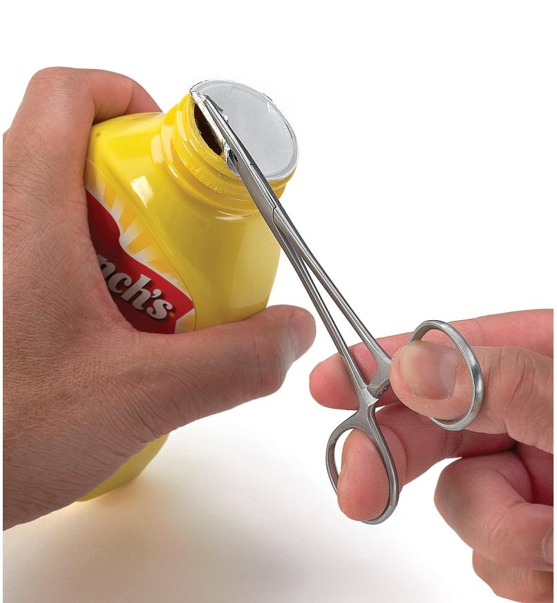 Using seal removal pliers to remove a seal from a mustard container