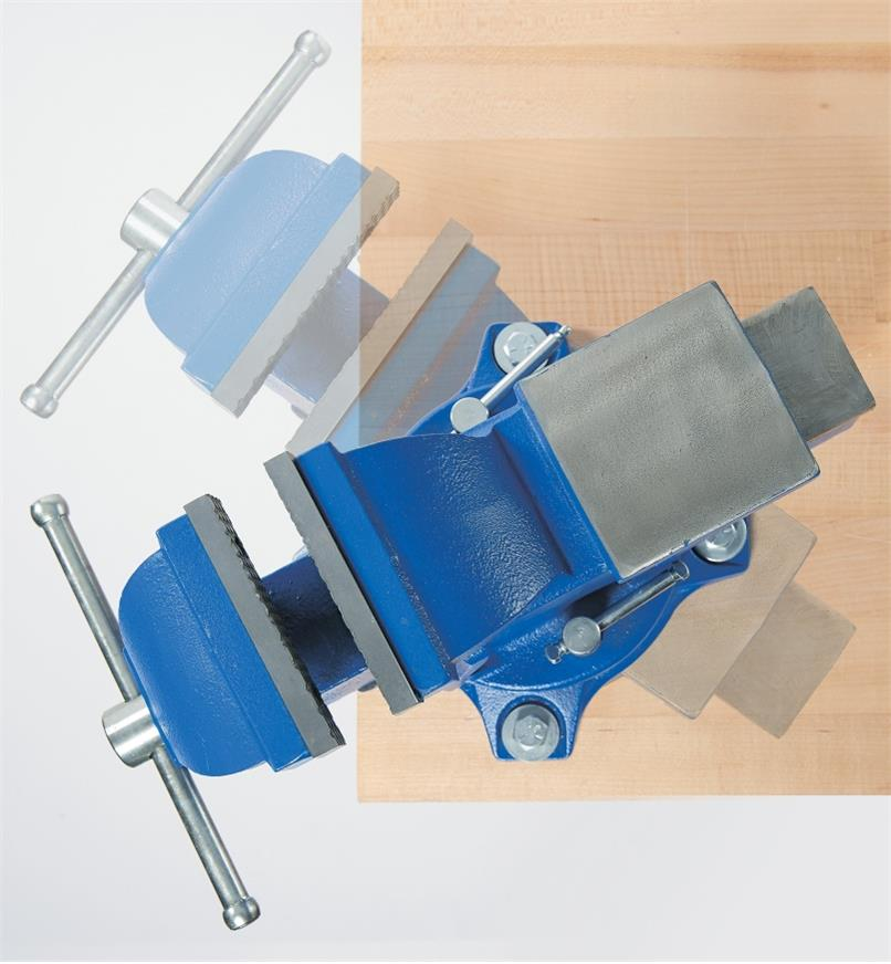 Top view of heavy-duty vise with ghosted image showing swivel action