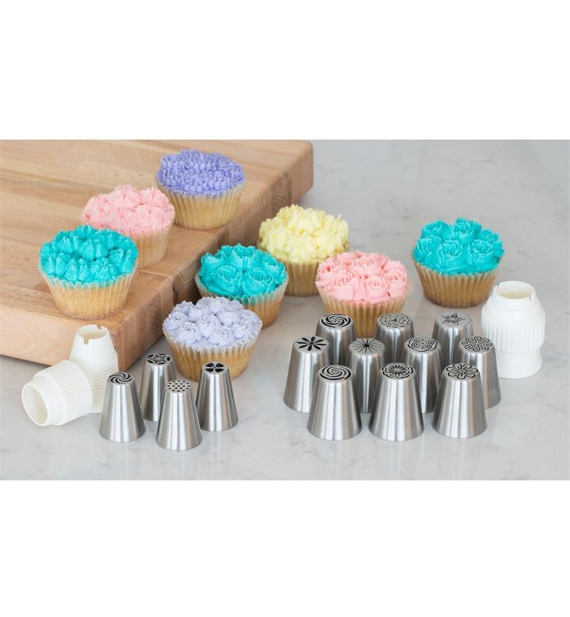 Decorative Piping Tips on a counter with samples of cupcakes frosted using the tips