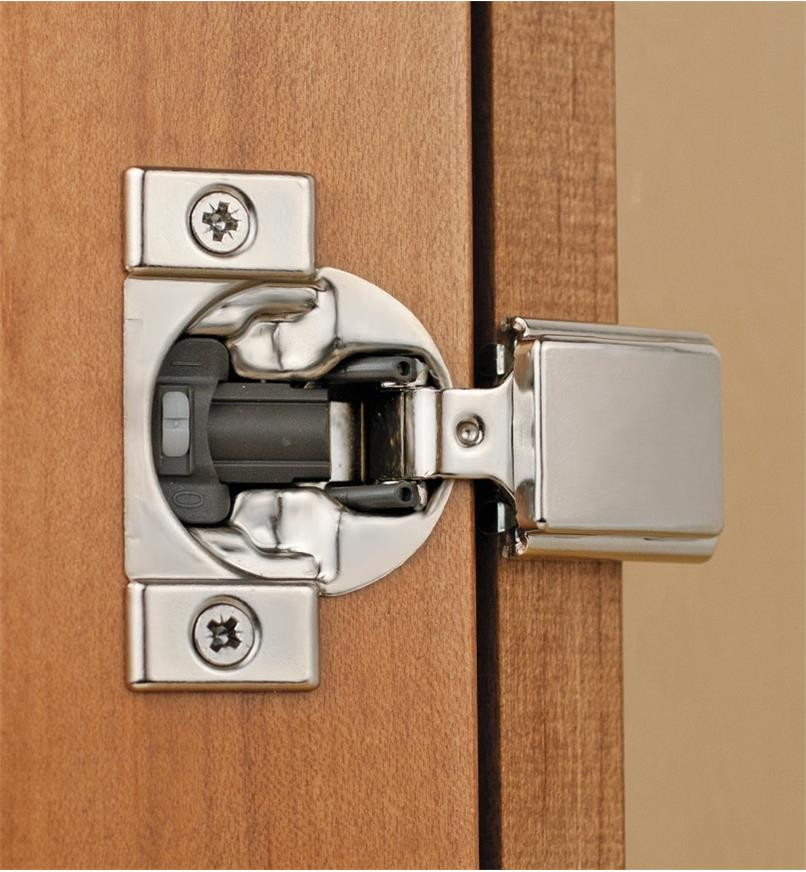 Compact Blumotion 105° Half-Overlay Hinge installed in a cabinet door