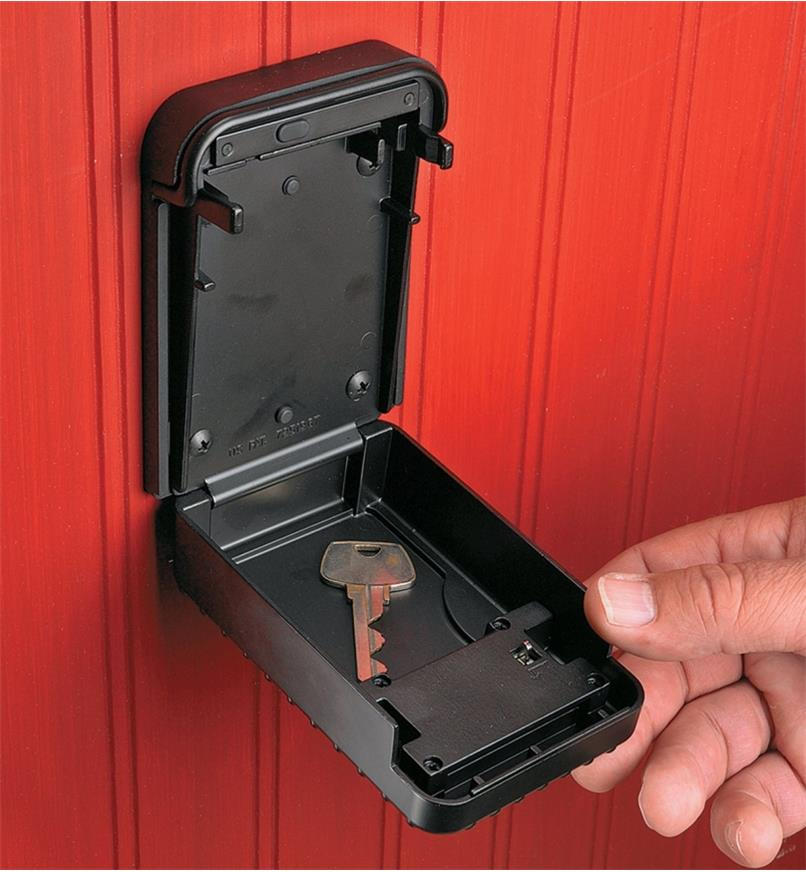 Wall-Mount Lockbox attached to a wall, opened to show a key inside