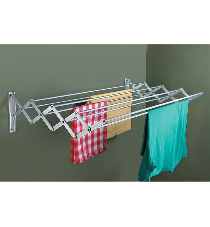 Clothing and towels hanging on the extended Accordion Dryer