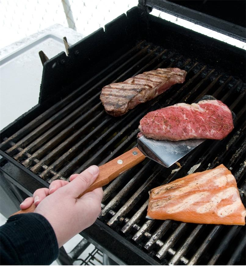 Using the Barbecue Grill Spatula to flip a steak on a grill