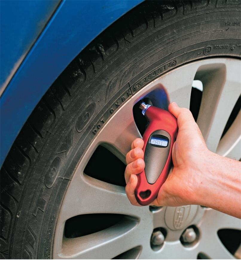 Checking tire pressure with a Digital Tire-Pressure Gauge