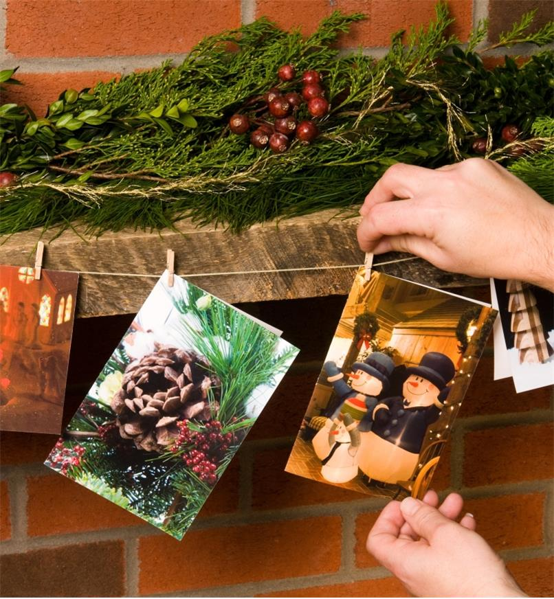 Hanging cards on a mantel using the Card Clothesline