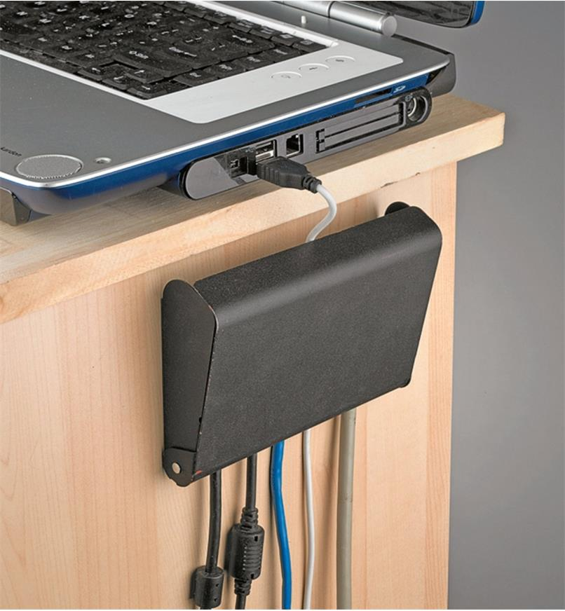 Cable box mounted on side of desk with lid closed
