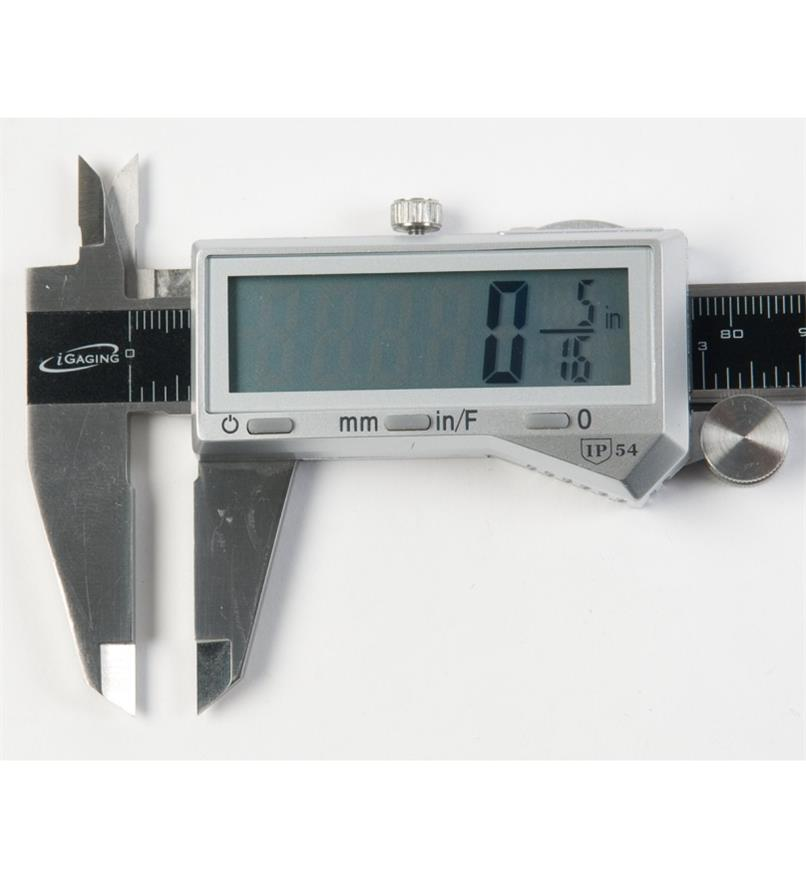 Close-up of caliper screen showing measurement in fractional inches