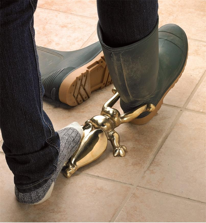 Using the Brass Beetle Bootjack to remove a boot