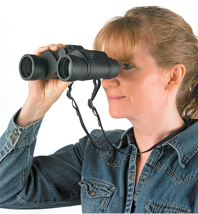 A woman looks through a pair of Binoculars