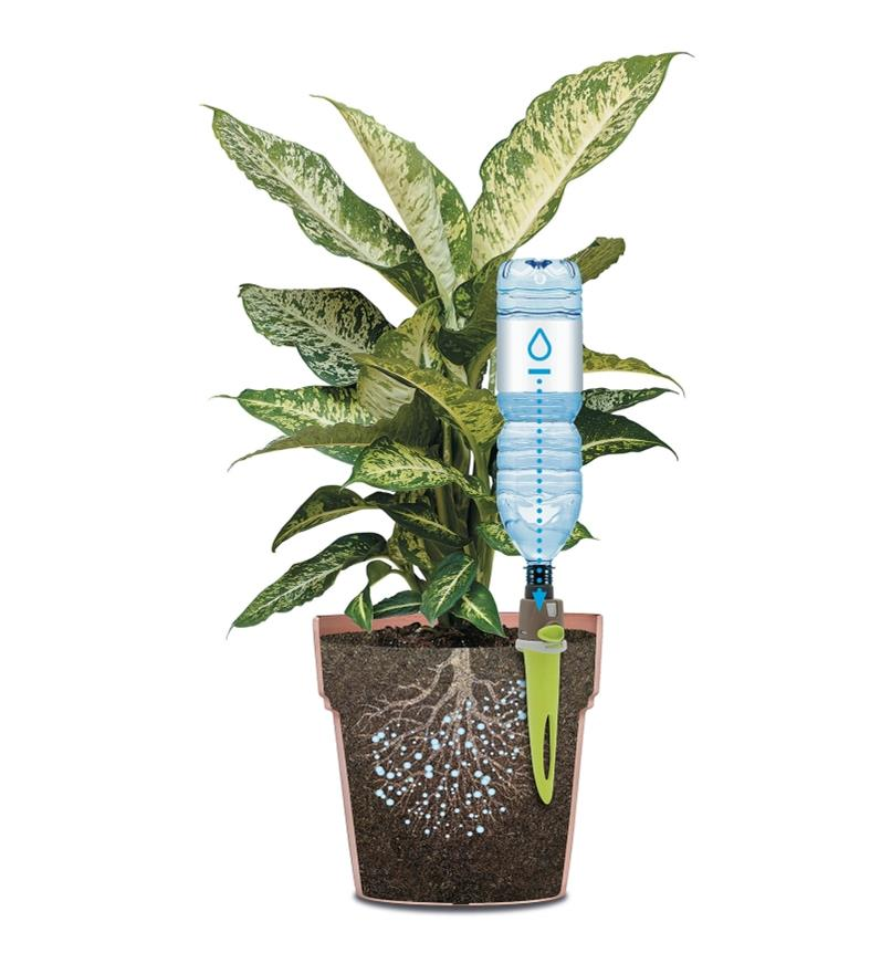 Cutaway illustration of adjustable-flow drip spike with a water bottle inserted in a plant pot