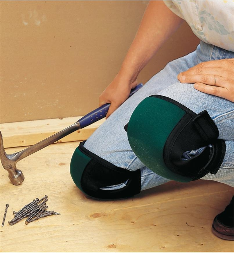 A woman wearing Contoured Knee Pads while doing construction
