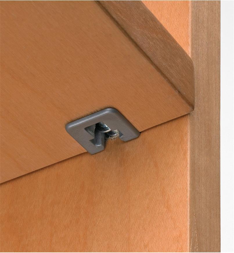 Underside view of Flipper Shelf Support installed in a shelf