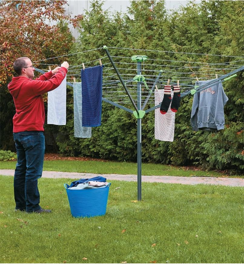 Folding Clothes Dryer with laundry hanging from the drying lines