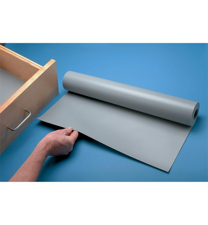 Unrolling a roll of Drawer/Shelf Liner