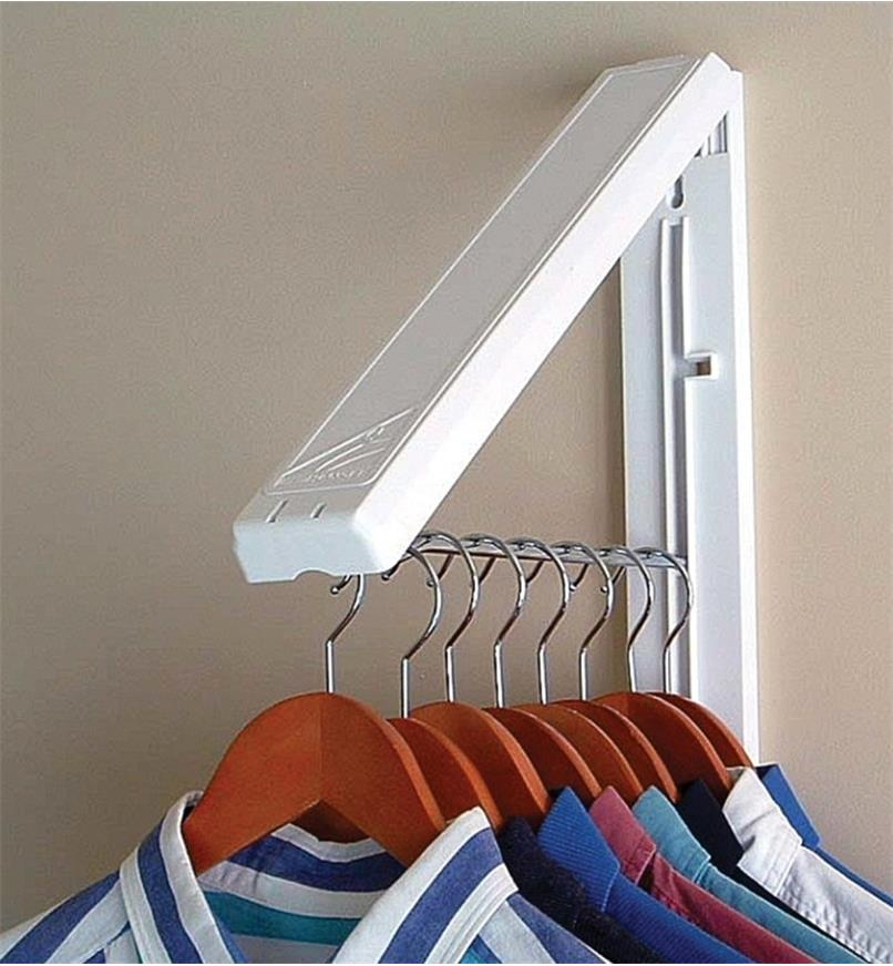 """Mounted 12"""" rack folded out, holding several shirts on hangers"""