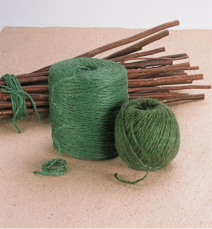 Two balls of Garden Twine beside a bundle of stick tied with twine