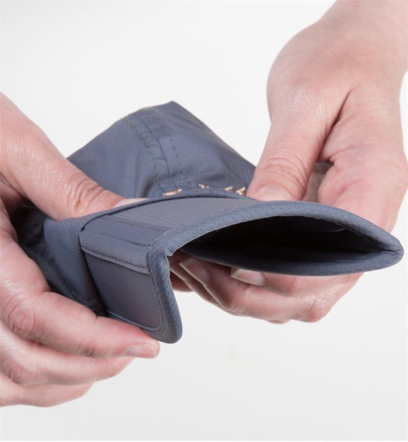 Folding the peak of the cap