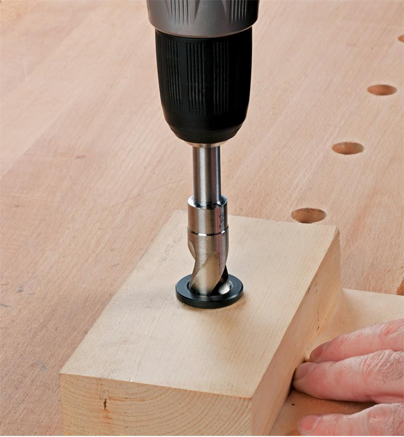 Shop-made drilling guide made with dog hole bushing