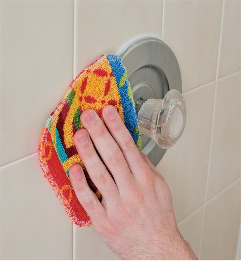 Using the Euroscrubby Scouring Pad to clean a shower faucet