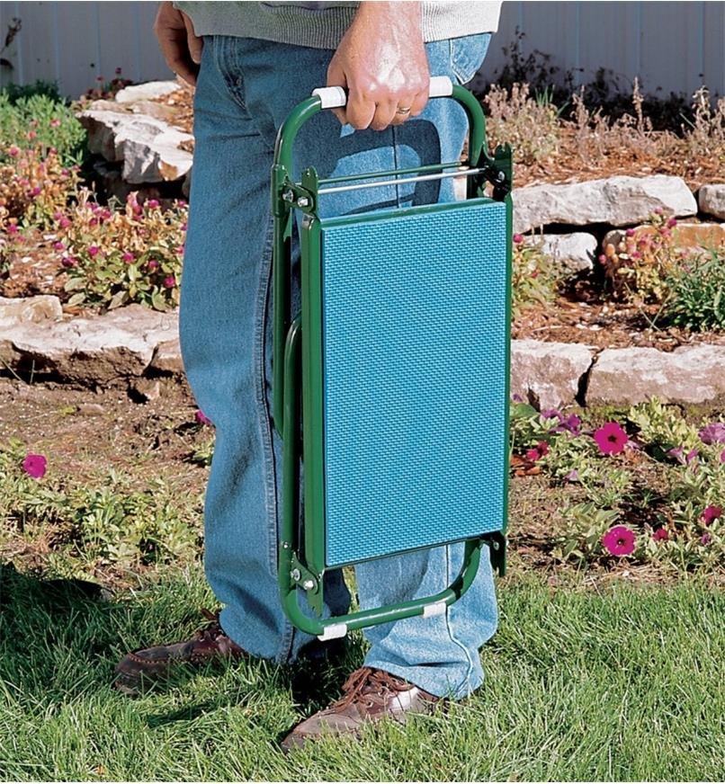 Carrying the folded kneeler stool