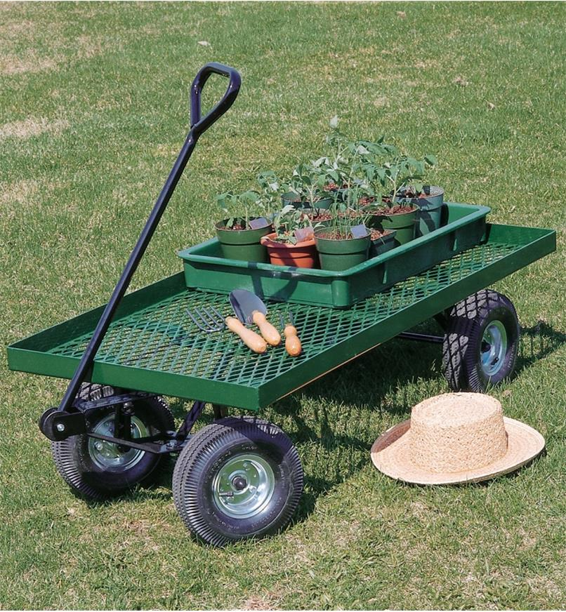 Garden Wagon holding gardening tools and a tray filled with seedling pots