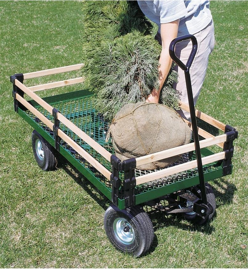 Loading a tree into the wagon with side racks