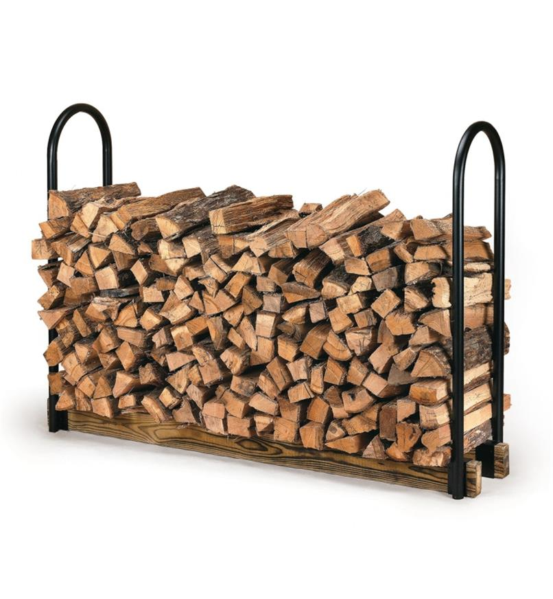 Firewood Storage Rack made with steel supports and 2 x 4s, filled with wood