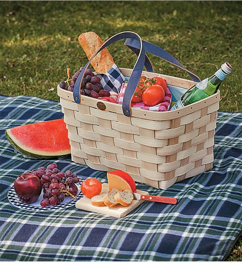 Handwoven Basket Tote on a picnic blanket, holding water and food items