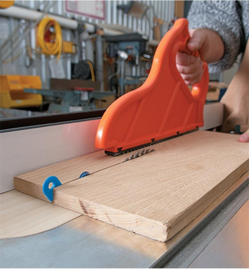Cutting solid wood on a table saw with the kerf keeper slanted out of position