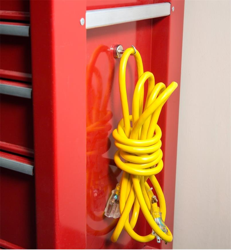 Extension cord hanging on a magnet-mounted hook attached to a tool chest