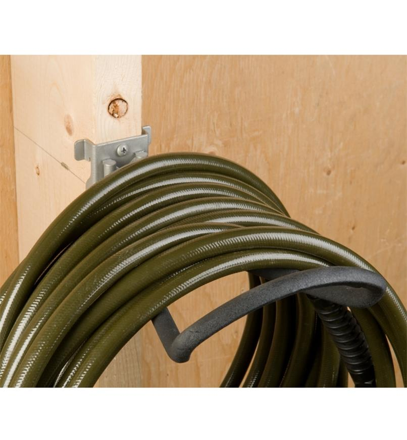 Loop Hook affixed to a stud, holding a hose