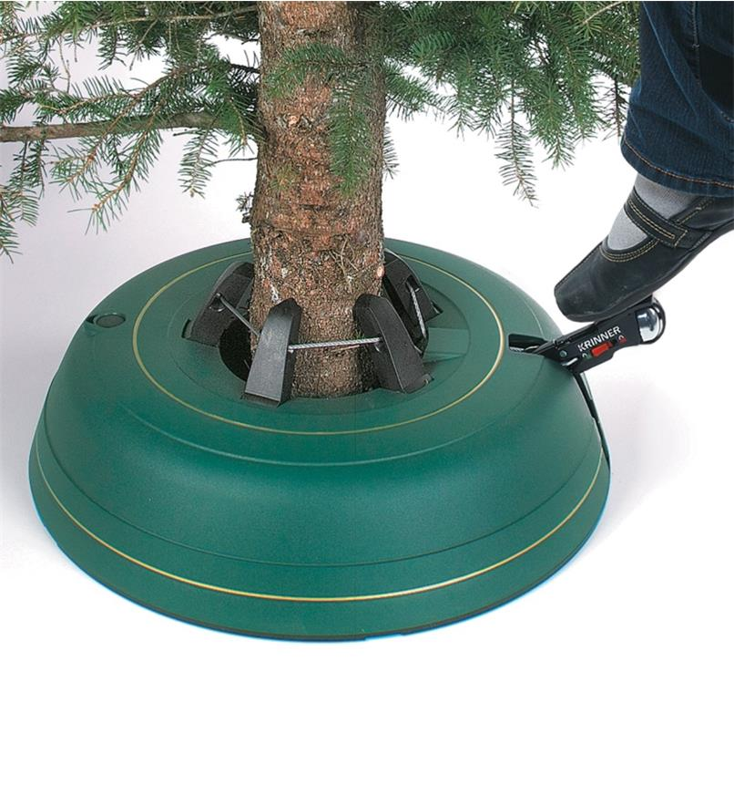 Pumping the foot pedal to secure the tree in the stand