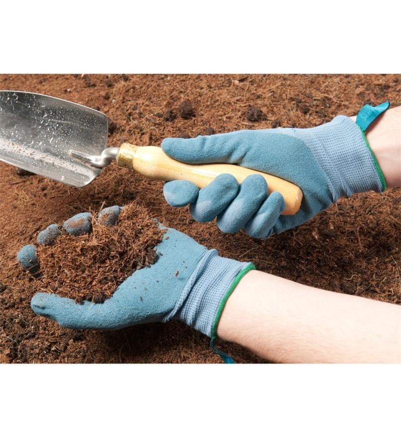 Digging in soil wearing the Lightweight Nitrile Gripper Gloves